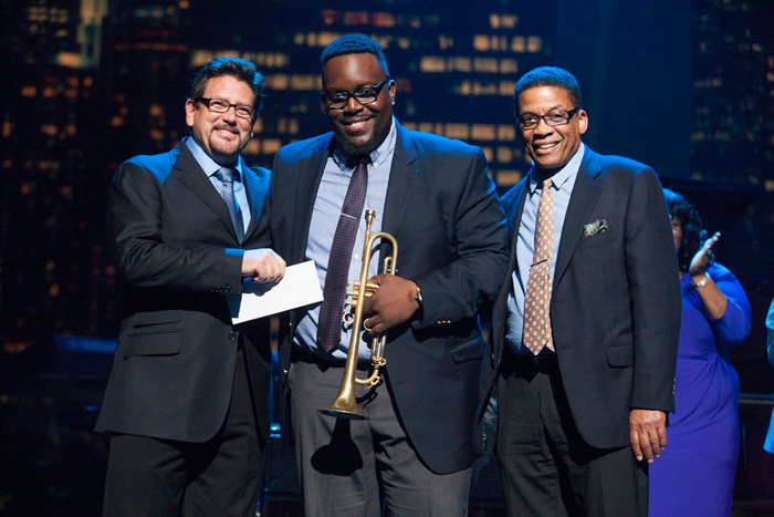Award presentation to 2014 Thelonious Monk International Jazz Trumpet Competition 1st place winner Marquis Hill by Herbie Hancock and John Burk, multi-Grammy Award winning producer and Chief Creative Officer of the Concord Music Group. From left: John Burk, Marquis Hill, Herbie Hancock. competition/2014competition.php'>Read More »