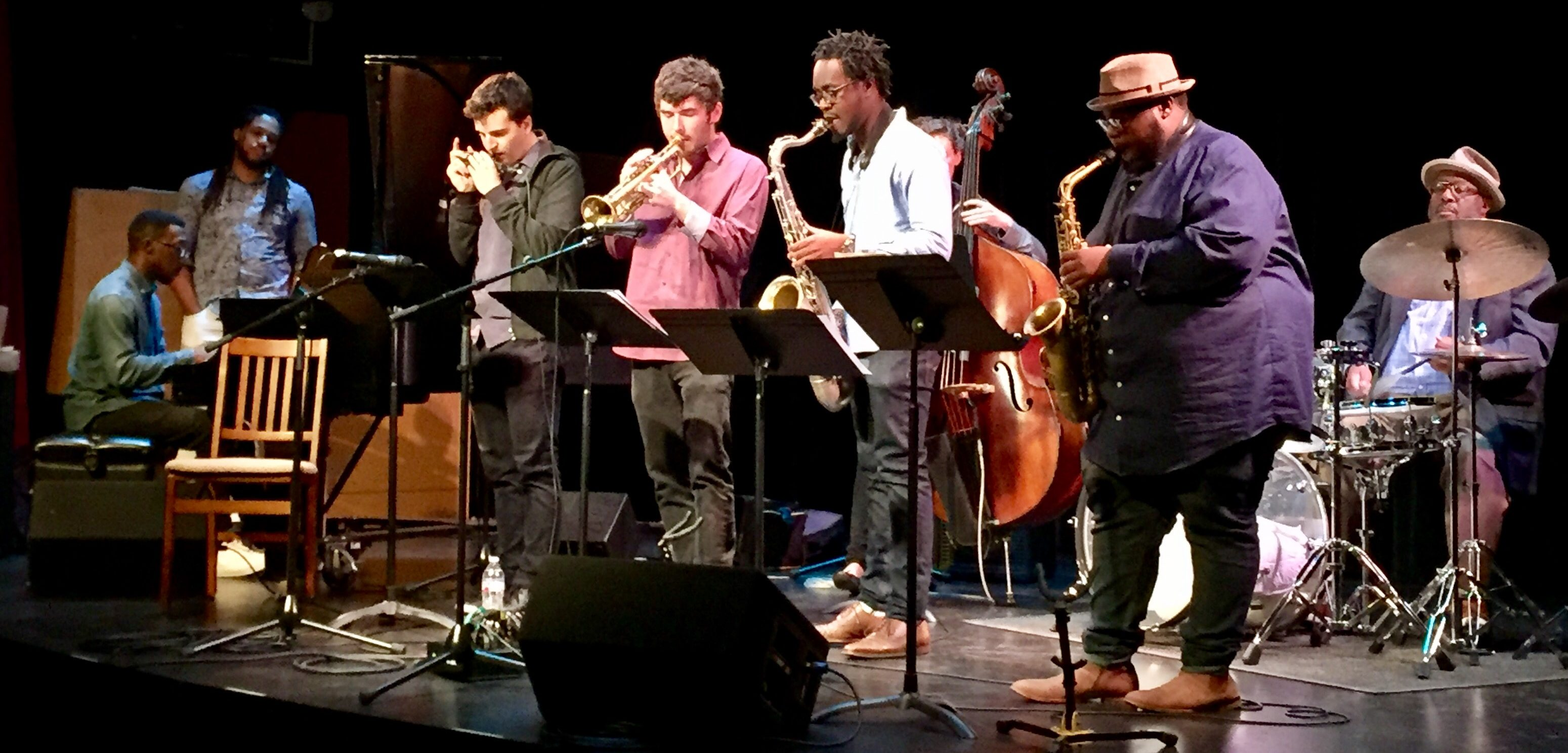 Drummer Carl Allen performs with the Thelonious Monk Institute of Jazz Performance Ensemble. Musicians onstage include a pianist, a harmonicist, a trumpeter, a tenor saxophonist, a bassist and an alto saxophonist.