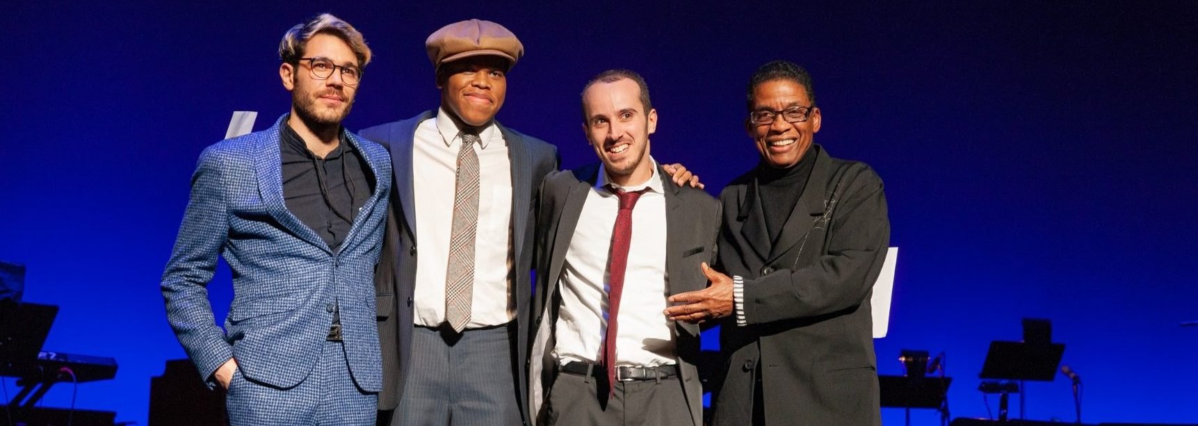 2018 Competition Finalists (from left) Maxime Sanchez, Isaiah Thompson and Tom Oren with Institute Chairman Herbie Hancock at the John F. Kennedy Center for the Performing Arts, December 3, 2018.