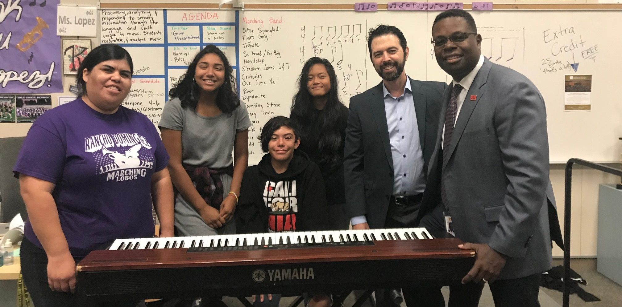Institute West Coast Director Daniel Seeff (second from right) and LAUSD Beyond the Bell Music and Entertainment Coordinator Tony White present a donated Yamaha P120 keyboard to the music program at Rancho Dominguez Preparatory School, a Jazz in the Classroom partner.